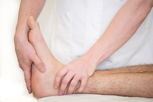 Osteopath examining a foot
